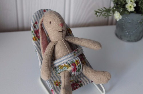 Micro bunny in bouncer chair