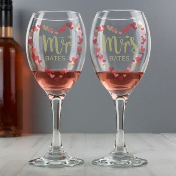 This Personalised Mr and Mrs Confetti Hearts Pair of Wine Glasses is perfect for celebrating a special occasion.