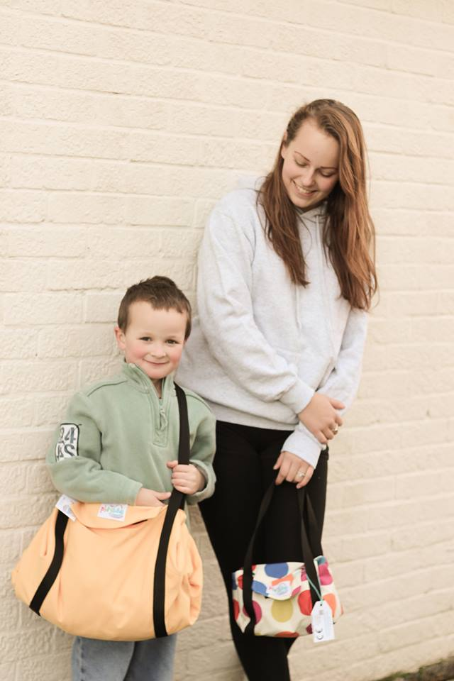 caitlin and peter with playbags