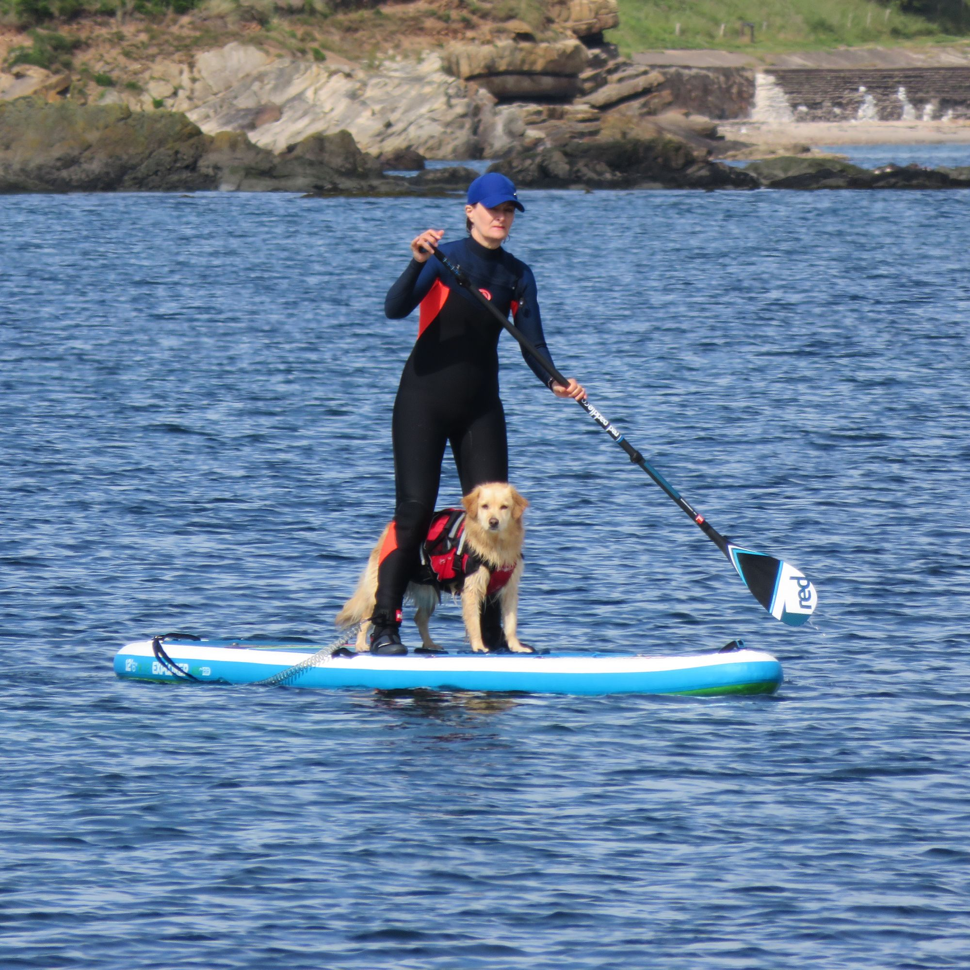 dawn and sandy paddle-boarding