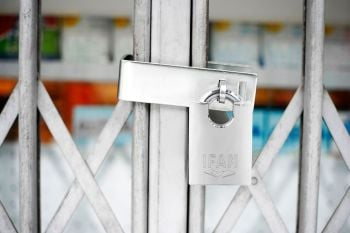 HEAVY DUTY HASP AND STAPLE GATE GUARD PLUS MAX50 CORROSION RESISTANT PADLOCK.