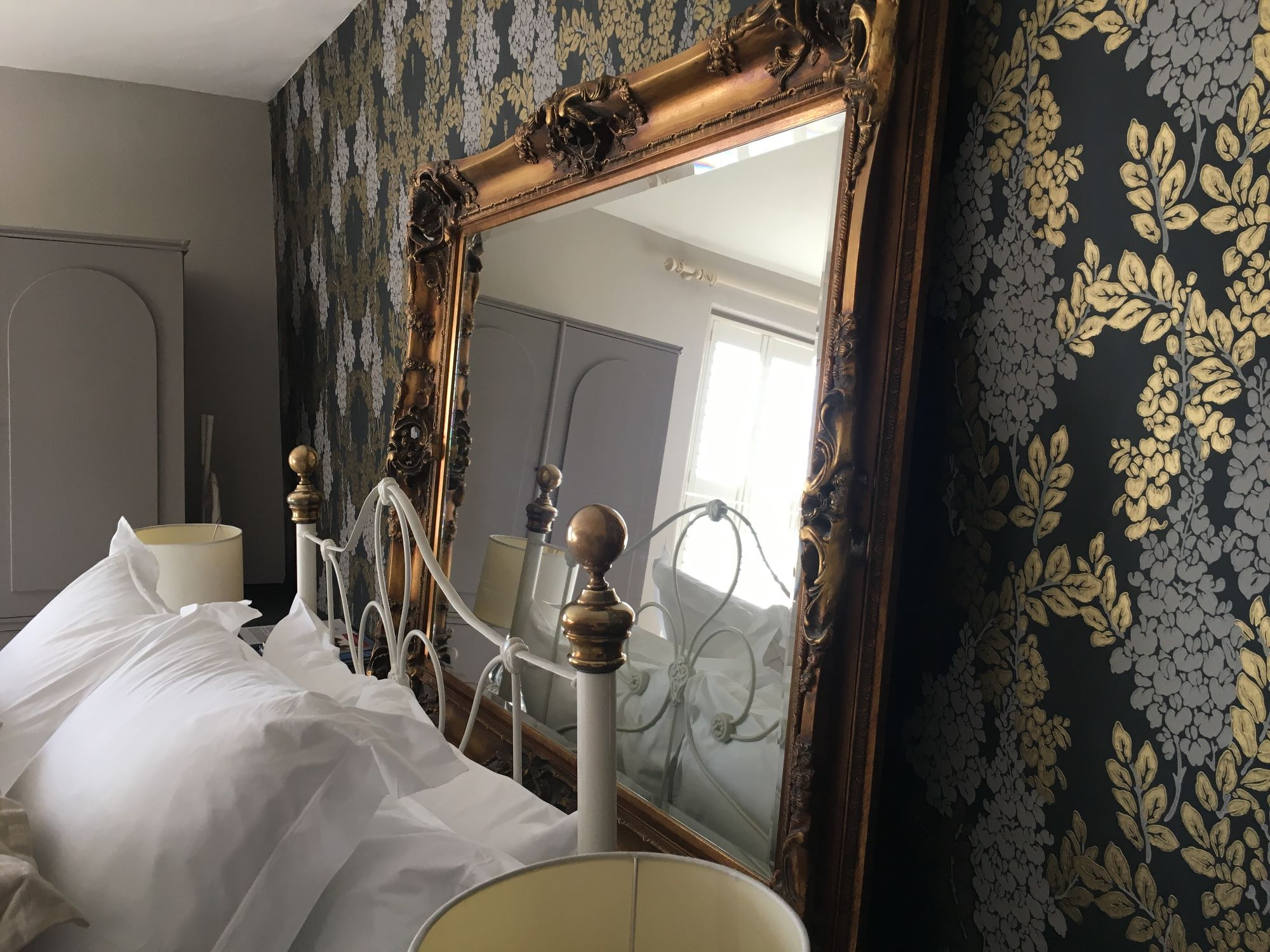 Brunee mirror from side of bed
