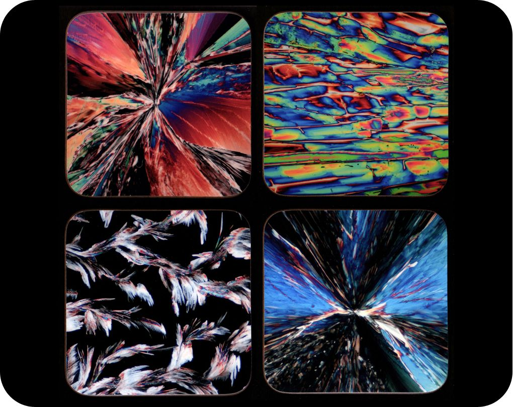 <!-- 00020 -->Four chemistry coasters - chemical crystals by polarised ligh