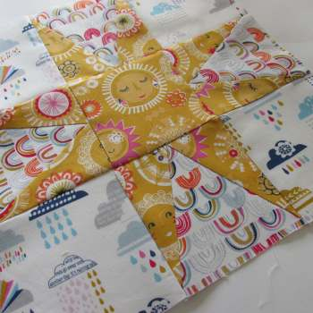 August (1) Block of the Month; Sunny with Showers