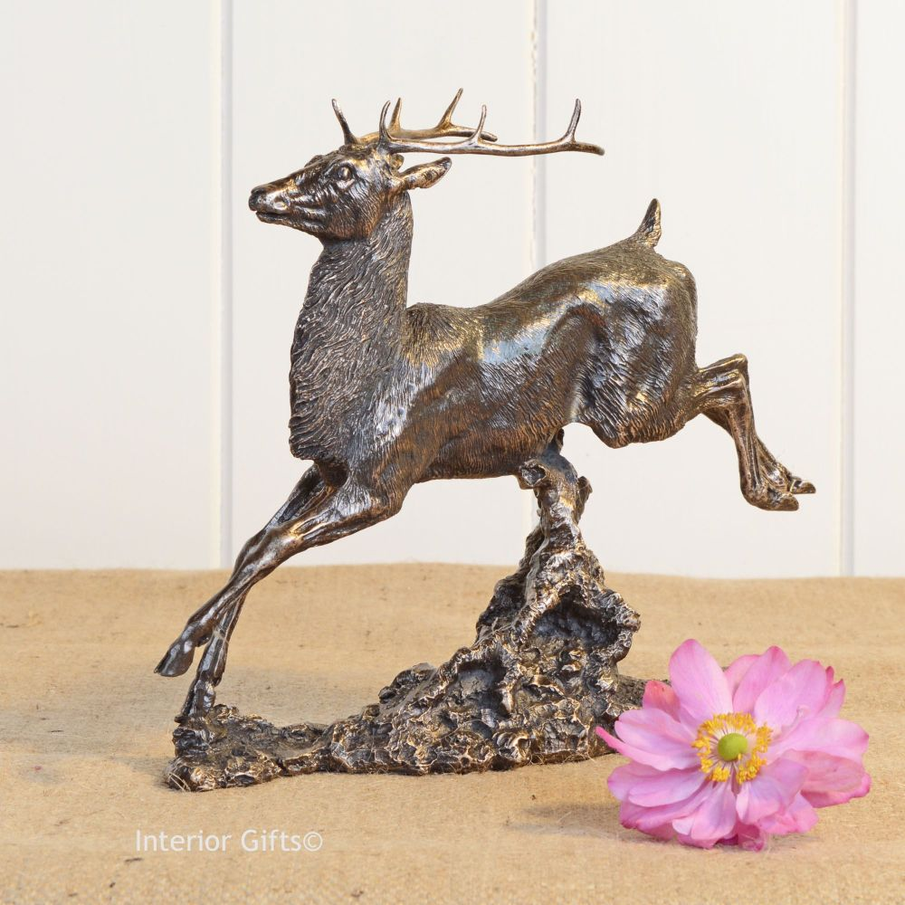 Bronze Sculpture of Majestic Jumping Stag
