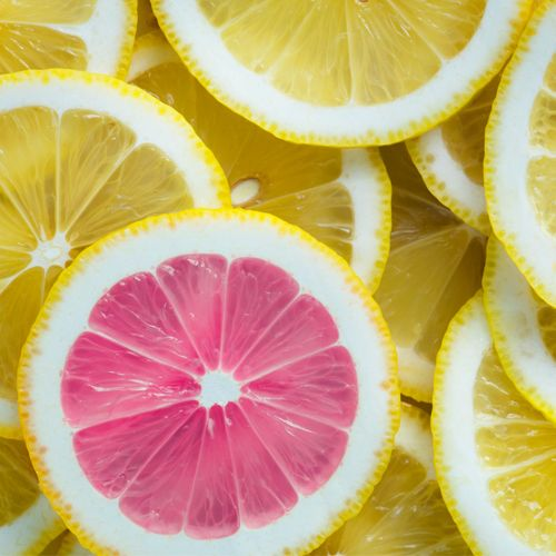 Sliced lemons.  All yellow except for one which is pink