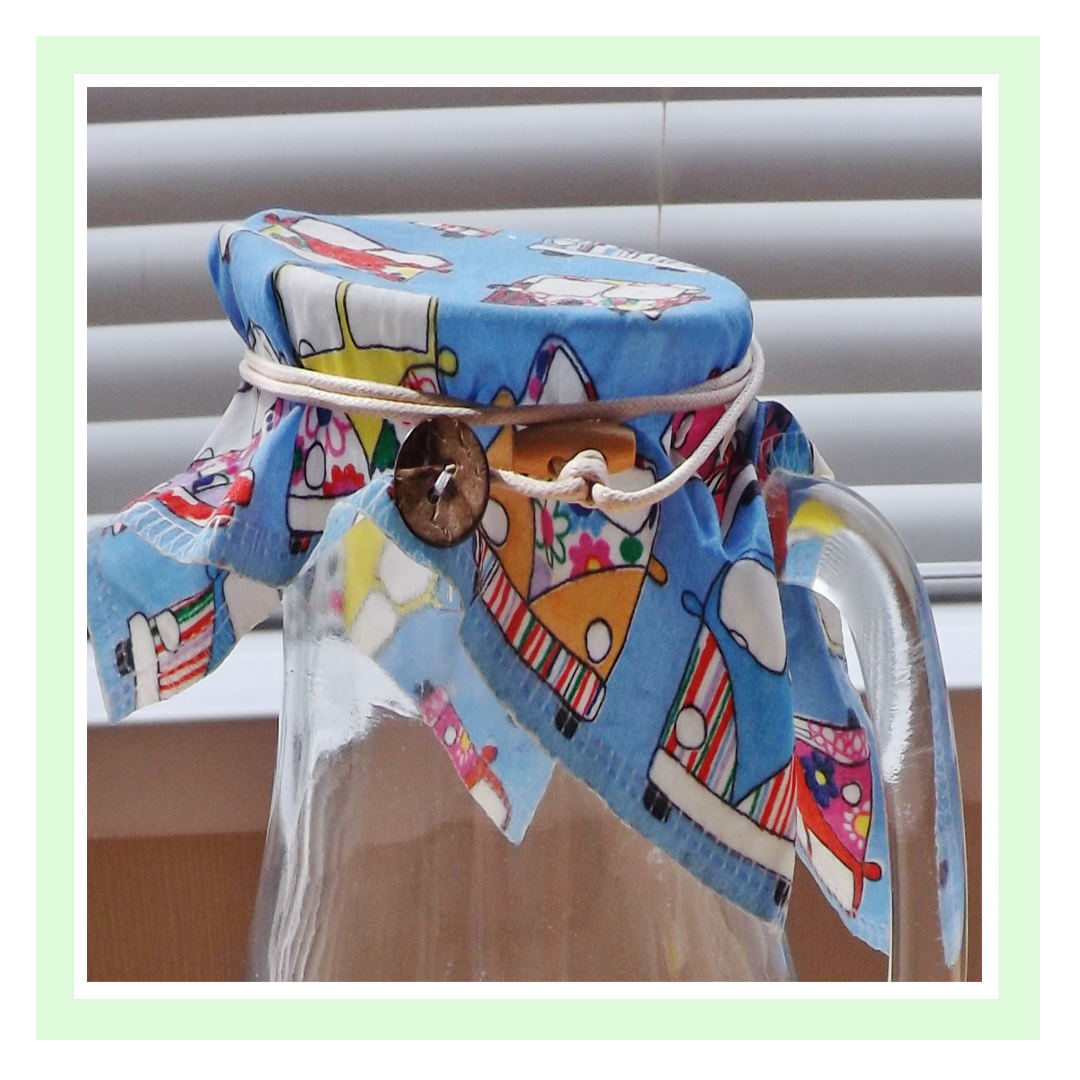 A blue campervan design WrapRound covering a glass jug
