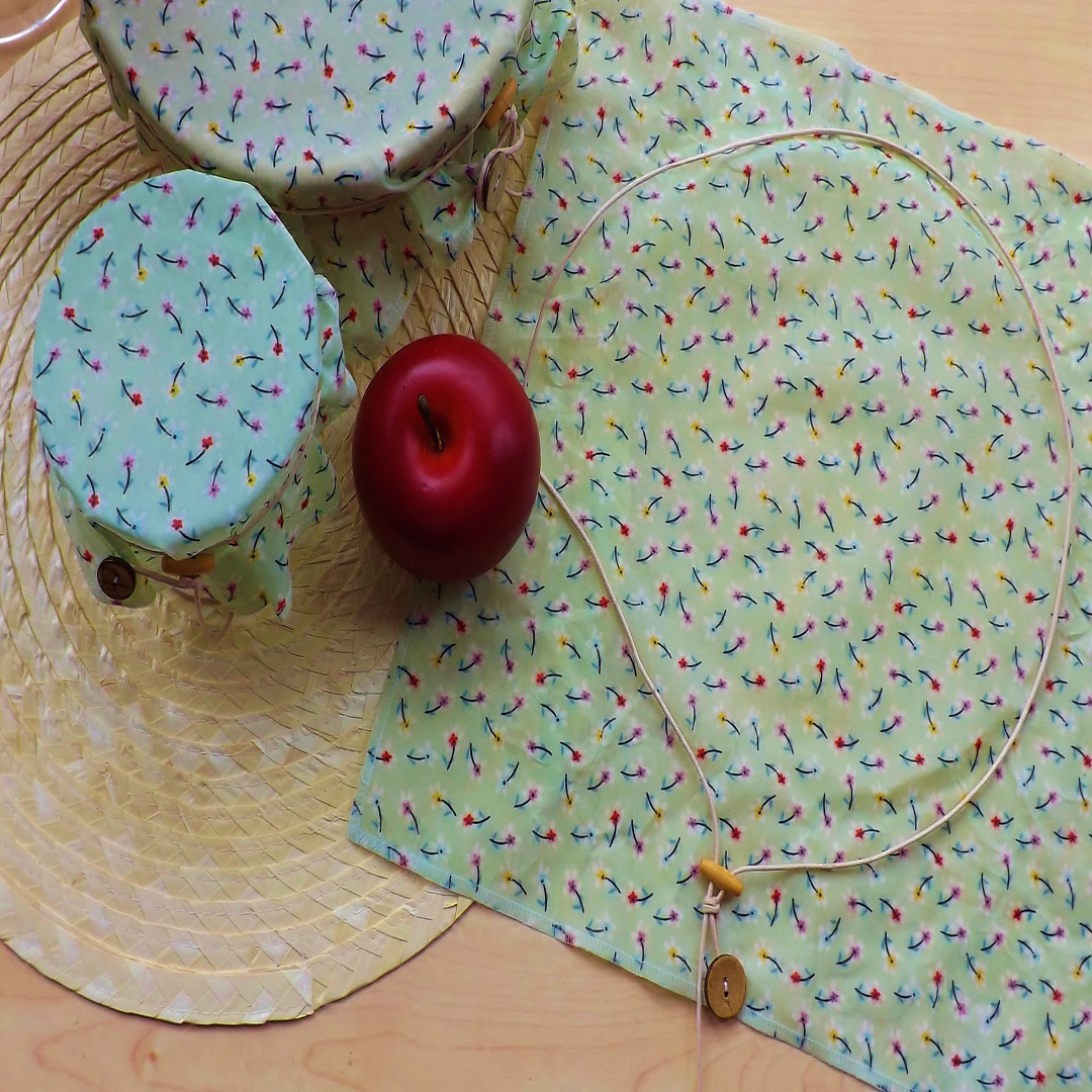 """V-Eco Food Wrapsâ""""¢,  WrapRound â""""¢- set of 3 floral waxed wraps next  to a red apple"""