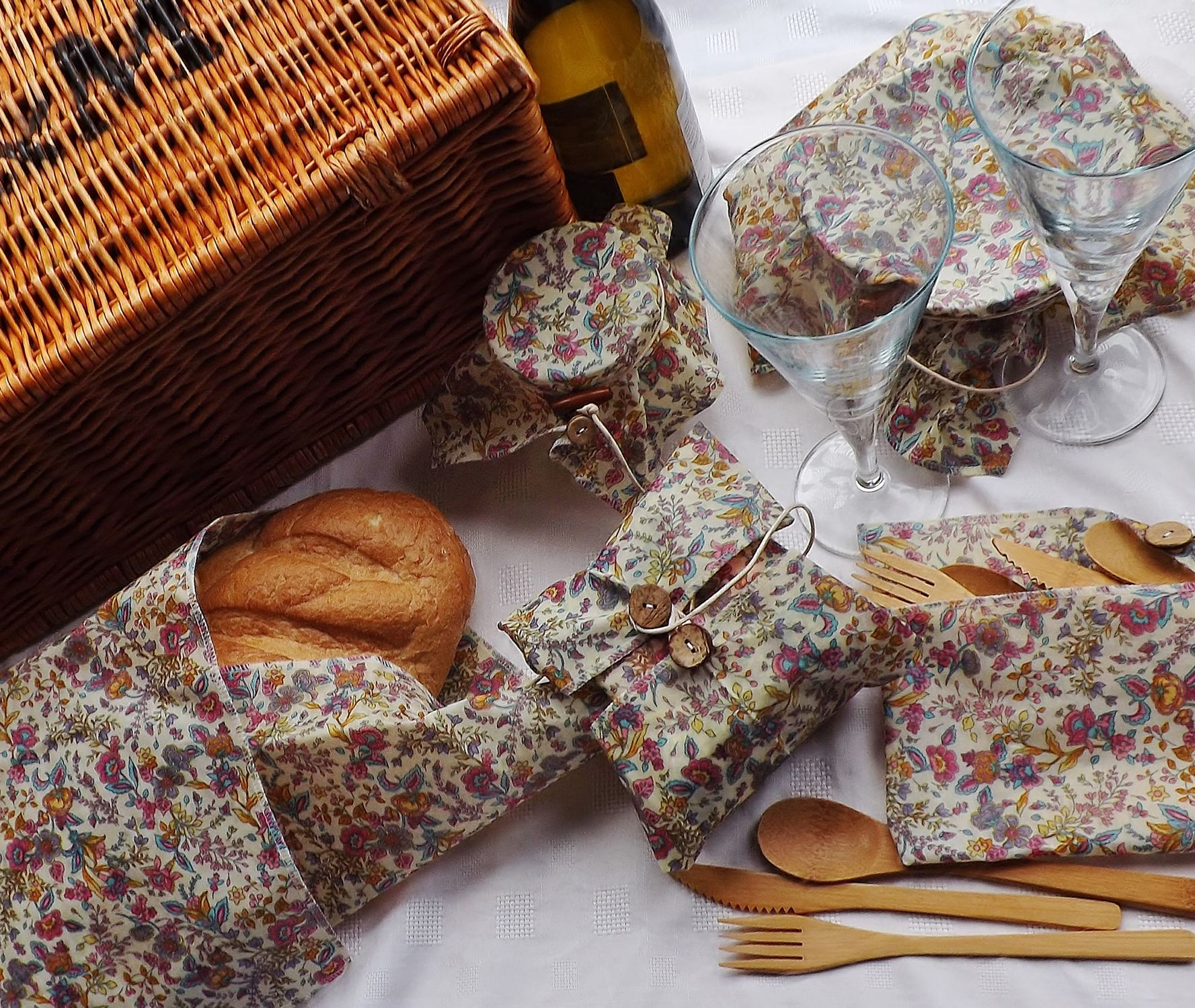 V-Eco Food Wraps, PicnicPack  - a variety of food in fabric waxed wraps  with bamboo cutlery, glasses and a picnic hamper basket