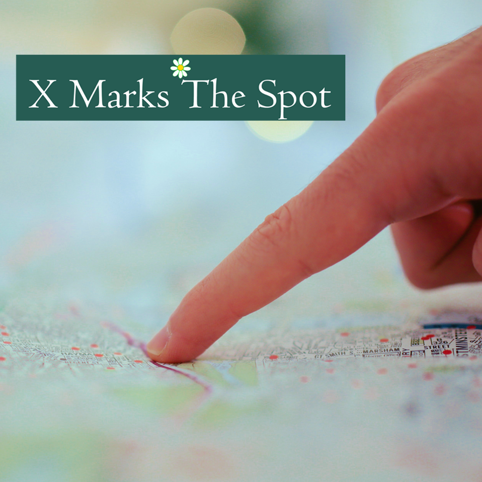 Finger pointing to a place on a map