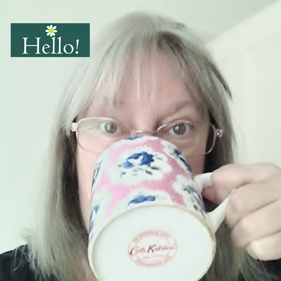 V-Eco Home, image of Jan, the owner drinking tea from a pink, blue and white floral mug