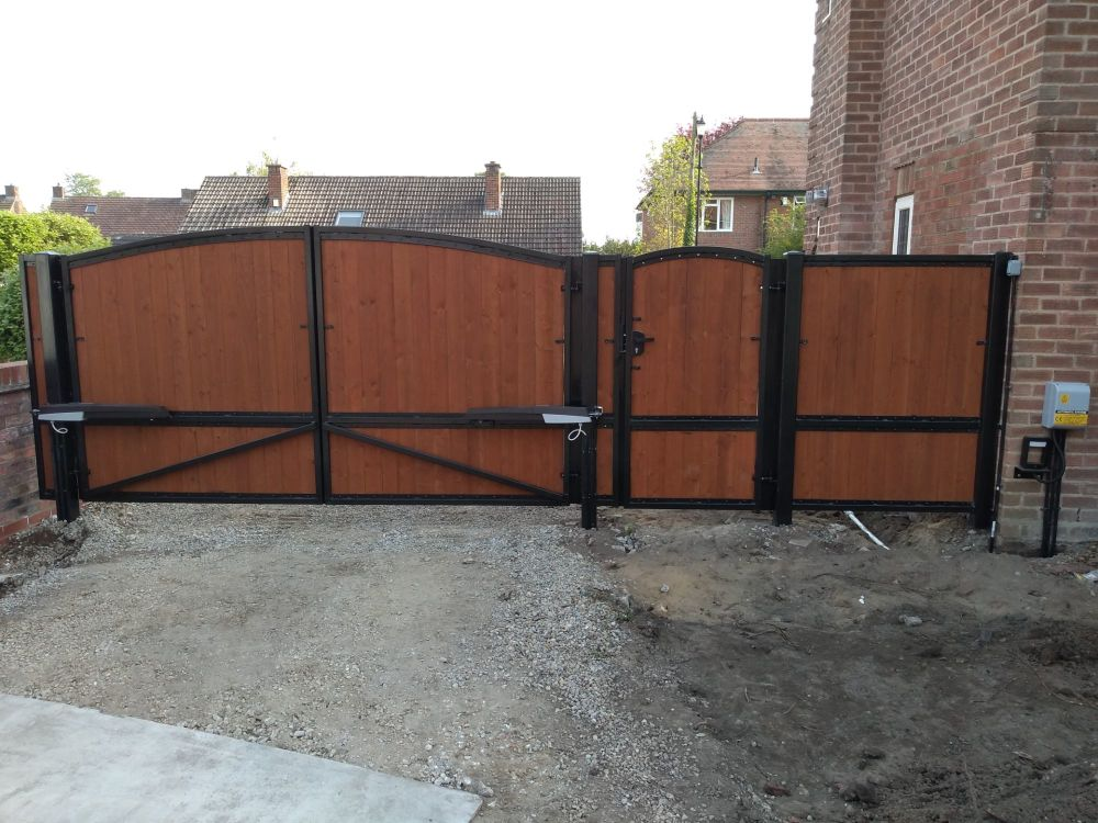 York Gates wood infill automated double gates, single and matching panel vi