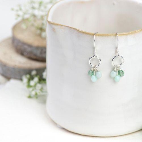 Silver green glass bead cluster earrings