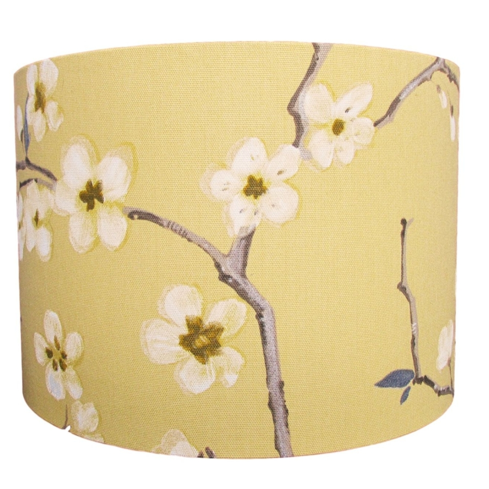 Traditional floral lampshade showing blossom on a yellow background