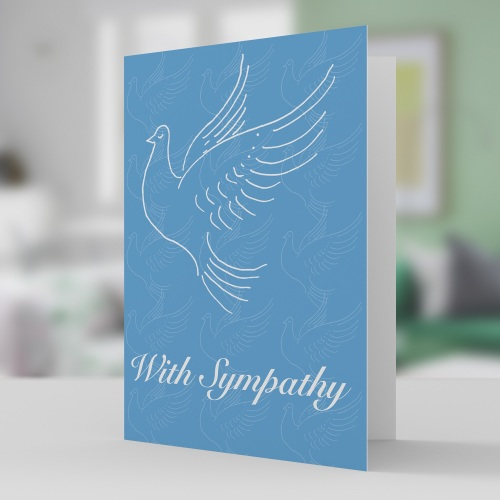 With sympathy card with white doves