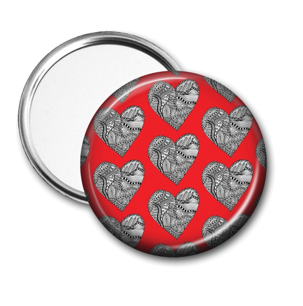 Doodle heart pocket mirror on a red background