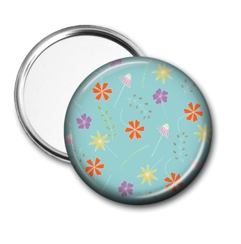 Pocket mirror with floating flowers on a turquoise background