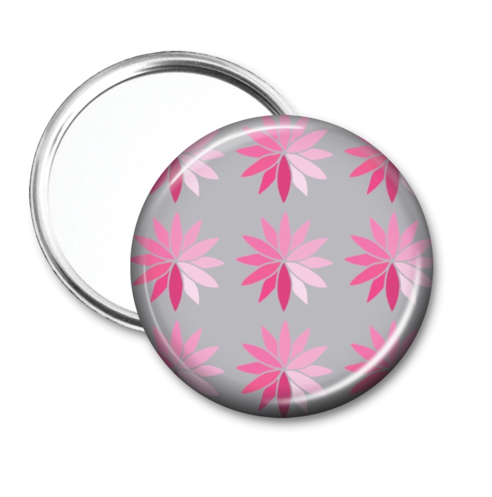 Pocket mirror with pink stylised flowers on a grey background