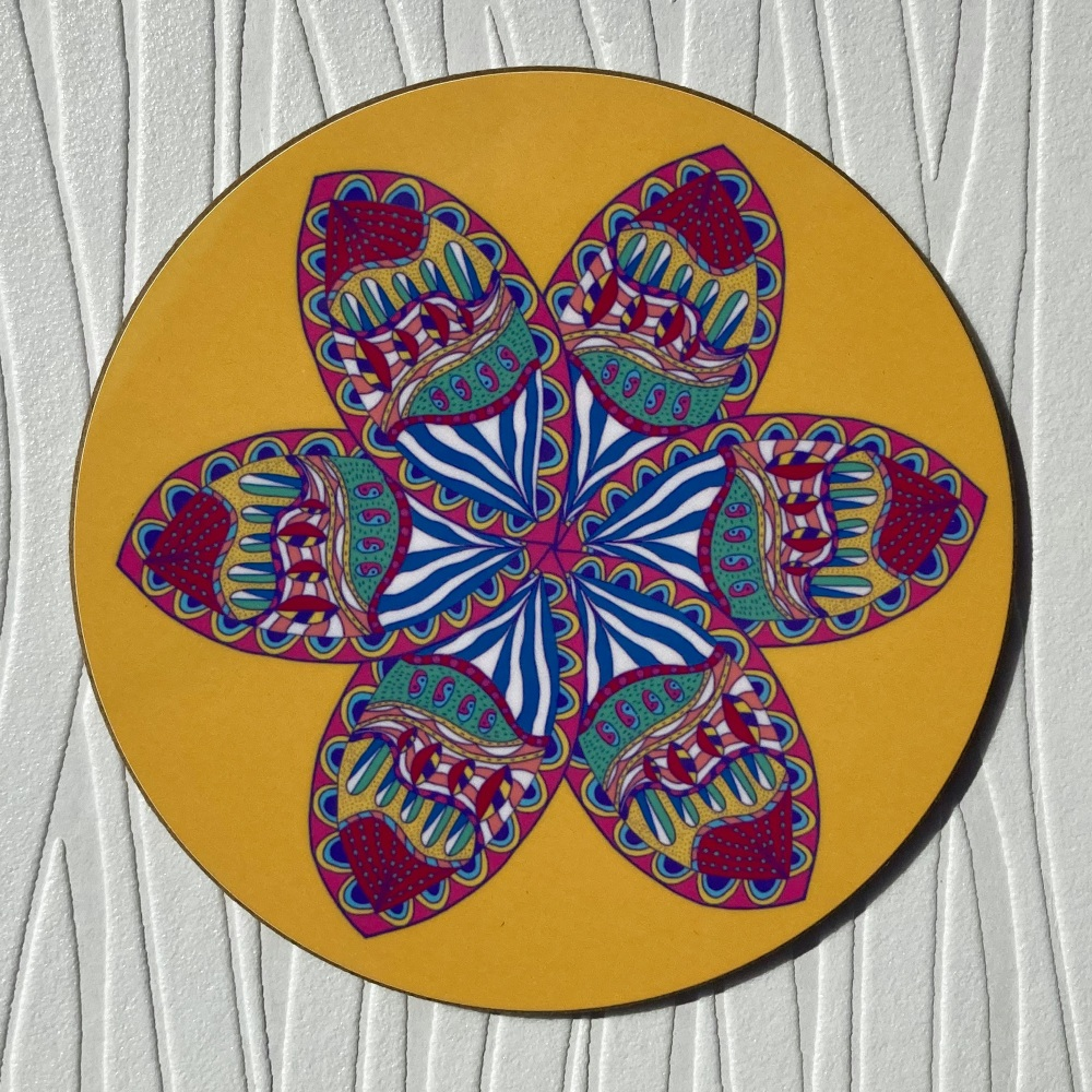 Circular yellow coaster with a stylised flower