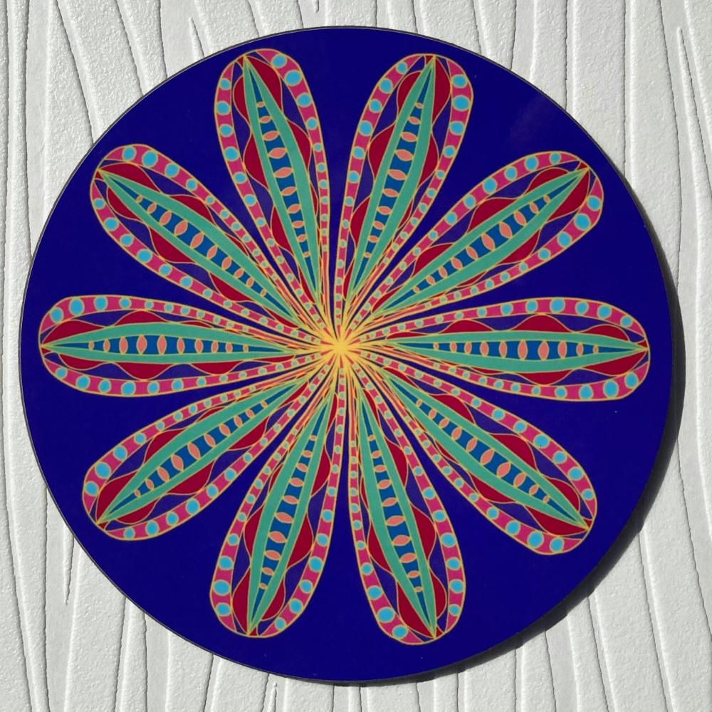 Circular purple coaster with stylised flower decoration