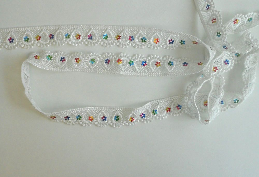 WHITE TRIM WITH MULTI COLOURED FLOWERS