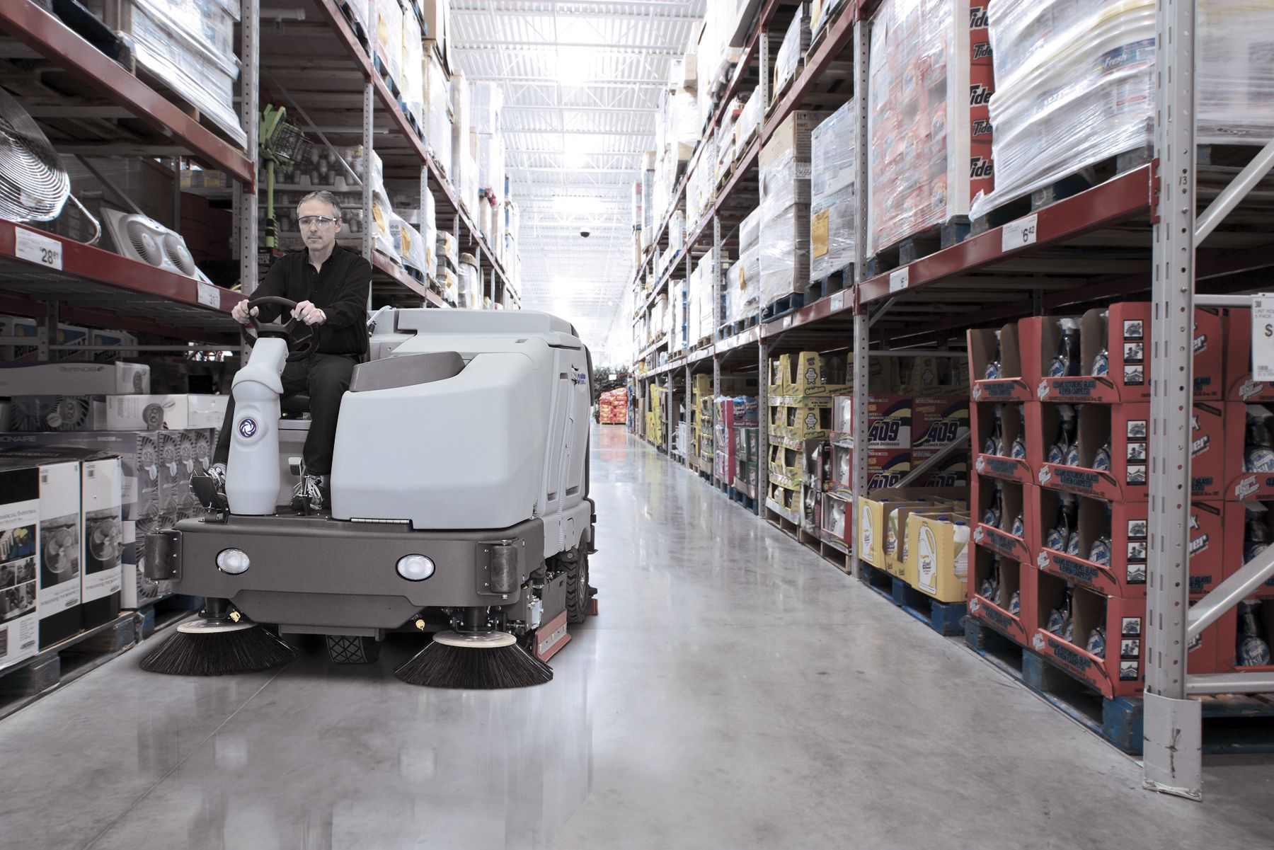Nilfisk SC8000 Ride On Scrubber Dryer In Use