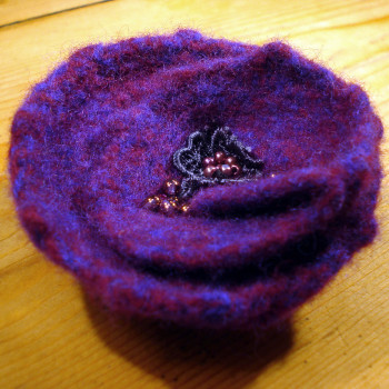 Felted and embroidered flower brooch