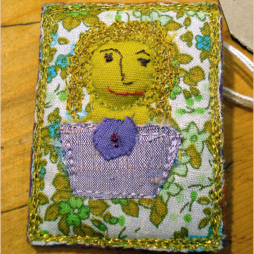 Embroidered portrait brooch