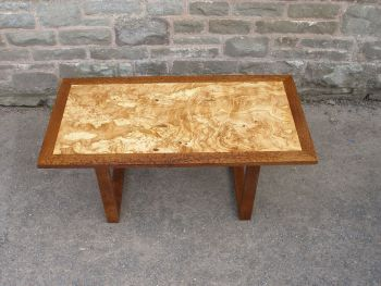 Coffee TableThis coffee table features spectacular burr ash veneer with solid wood frame and legs made from rare locally sourced brown oak.  Dimension