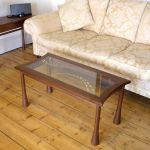 'Flow' coffee table - walnut with gilded glass