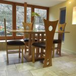 'Torres' dining chairs in maple.