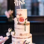 Semi Naked Pink Flowers Wedding Cake