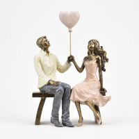 Couple in Love with Balloon Figure