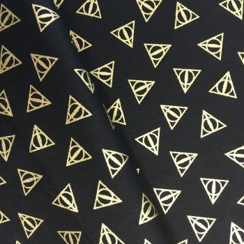 Harry Potter Deathly Hallows Logo Metallic Gold Hogwarts Magical Wizard Witch Cotton Fabric Wizarding World Collection per half metre