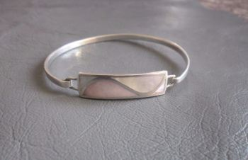 Sterling silver and Mother of Pearl bangle; wave design