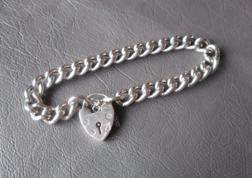 Traditional vintage sterling silver charm bracelet