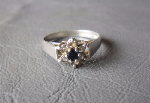 Vintage silver cluster ring with a deep blue sapphire