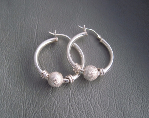 Sterling silver hoop earrings with glitter balls