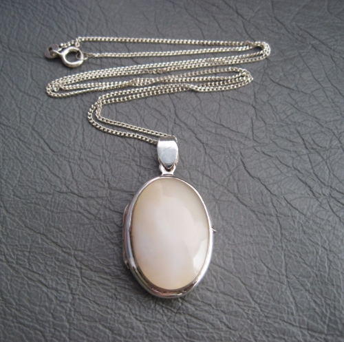 Sterling silver locket with a Mother of Pearl front