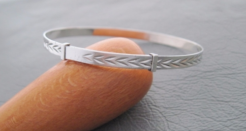 Vintage silver Christening bangle with a chevron design