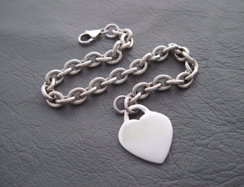 Sterling silver bracelet with a single solid heart charm