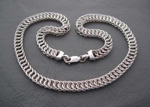 Heavy sterling silver necklace with woven circular links