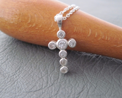 Sterling silver necklace with a small clear stoned cross pendant
