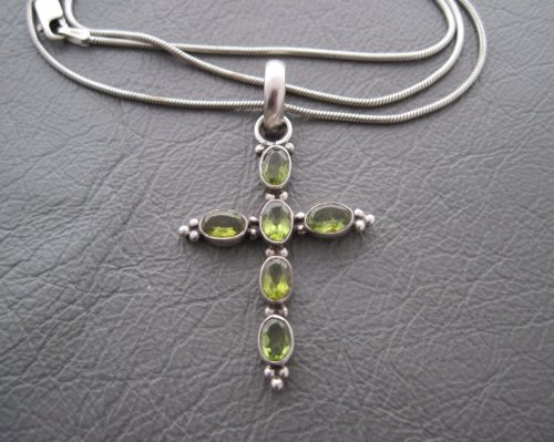 Sterling silver necklace with a peridot set cross pendant
