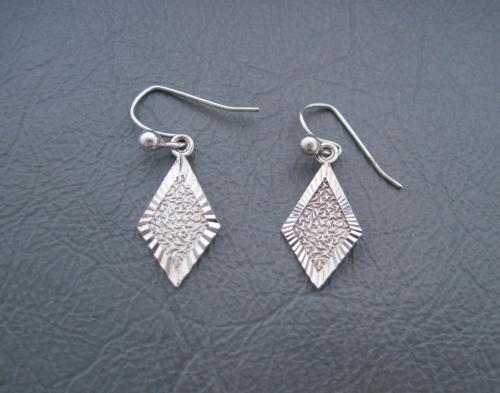 Silver textured diamond shape drop earrings