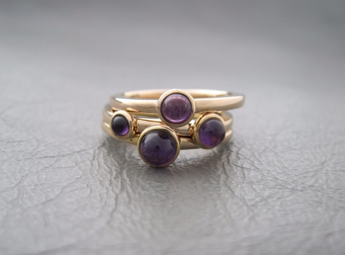 Gilt sterling silver stacking rings set with amethyst