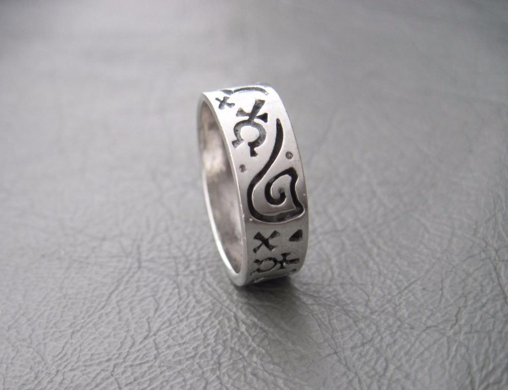 Sterling silver ring; symbols band