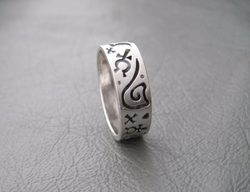 Sterling silver ring; symbols band
