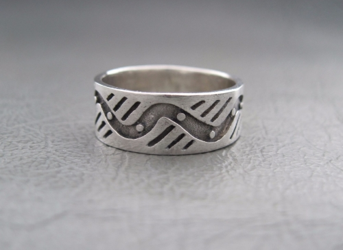 Sterling silver ring; wave, dots & stripes band