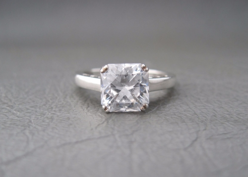 Sterling silver proud set square solitaire ring